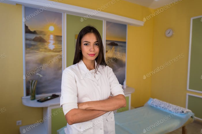 young beautiful professional cosmetician in modern salon