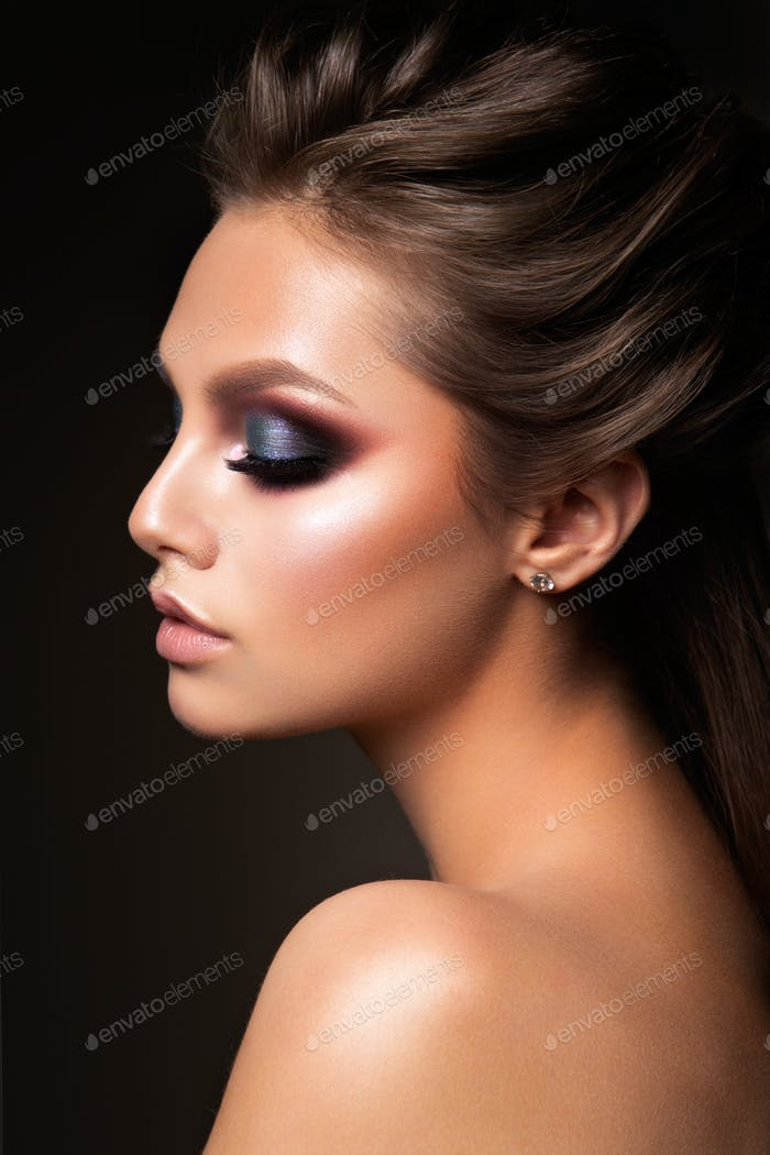 Close-up of beautiful female face with colorful make-up
