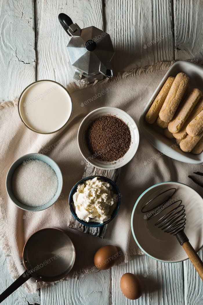 Ingredients for tiramisu on the  white wooden background
