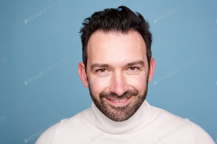 Close up handsome man with beard against blue background