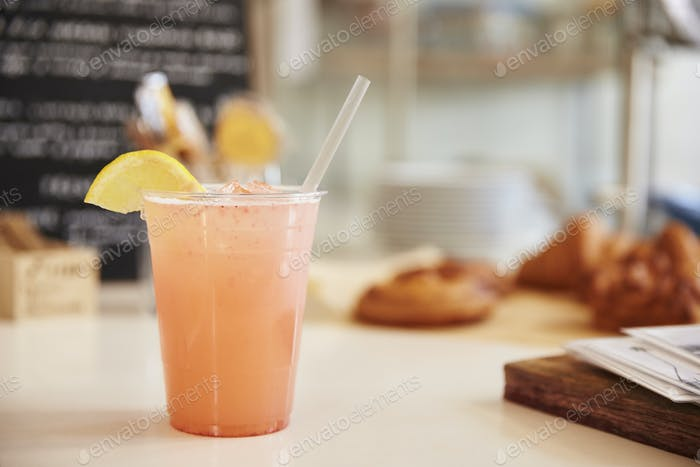 Glass of lemonade on the counter at a coffee shop, horizontal
