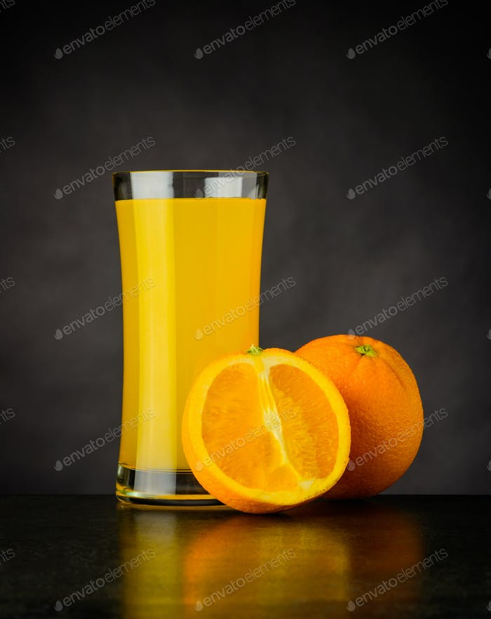 Fresh Orange Juice on Dark Background