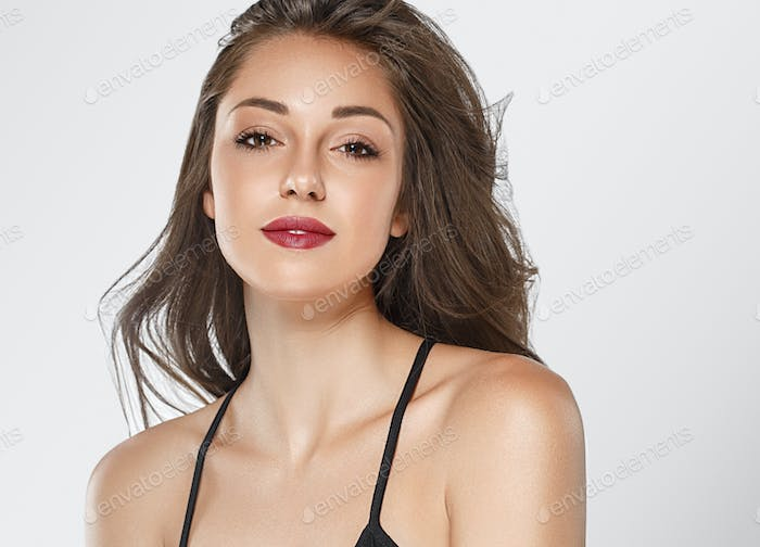 Beautiful woman face close up studio portrait with red lips and beauty hair