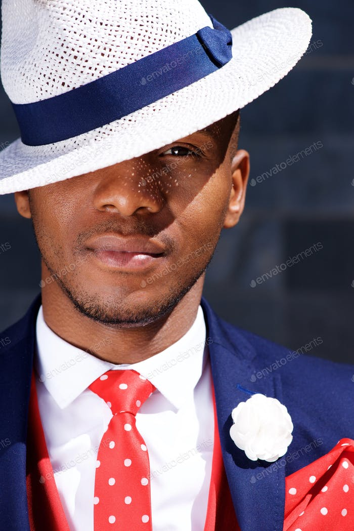 handsome young african businessman in hat