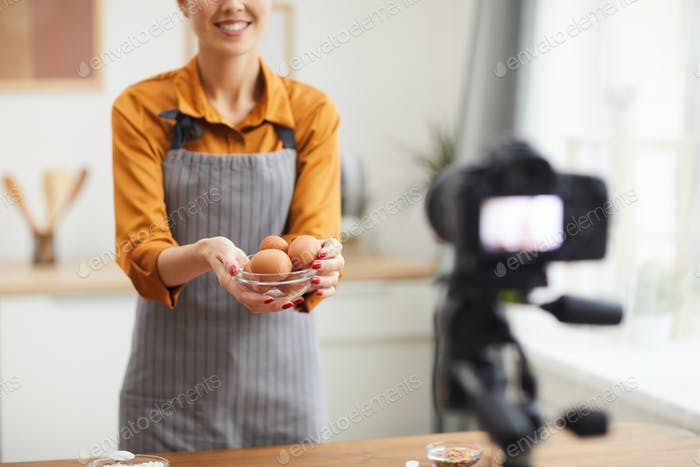 Smiling Woman Filming Baking Video