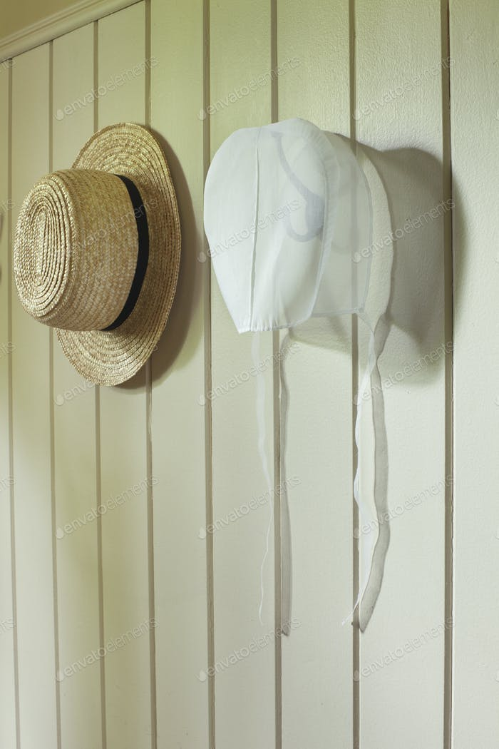 Amish Straw Hat and Bonnet Hangin on a Wall