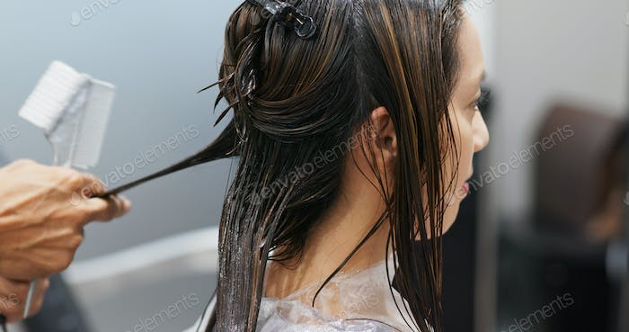 Woman having hair treatment in hair salon