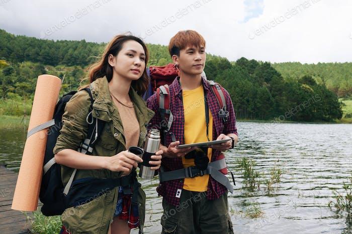 Asian Couple Enjoying Hiking Trip