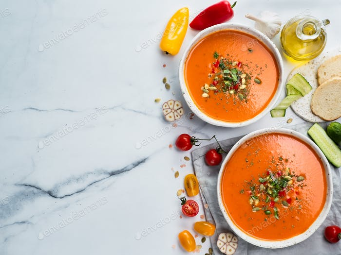 Gaspacho soup on light marble, top view