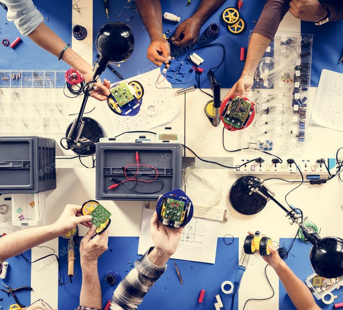 Technician team working at electronics repair shop