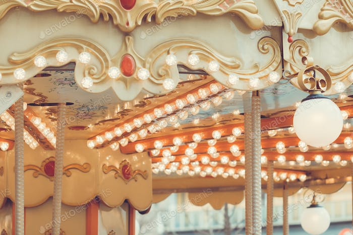 Details of a vintage carousel. Retro toned.