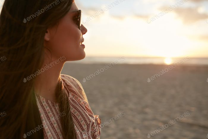 Attractive woman on the beach at sunset