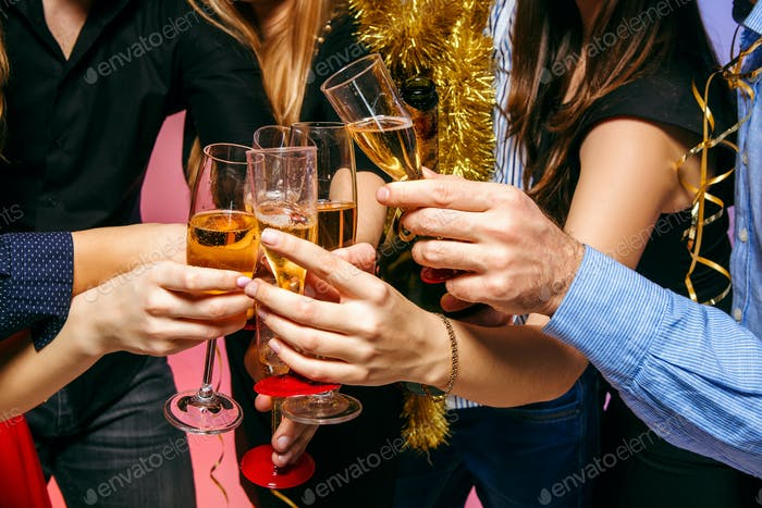Many young women and men drinking at christmas party