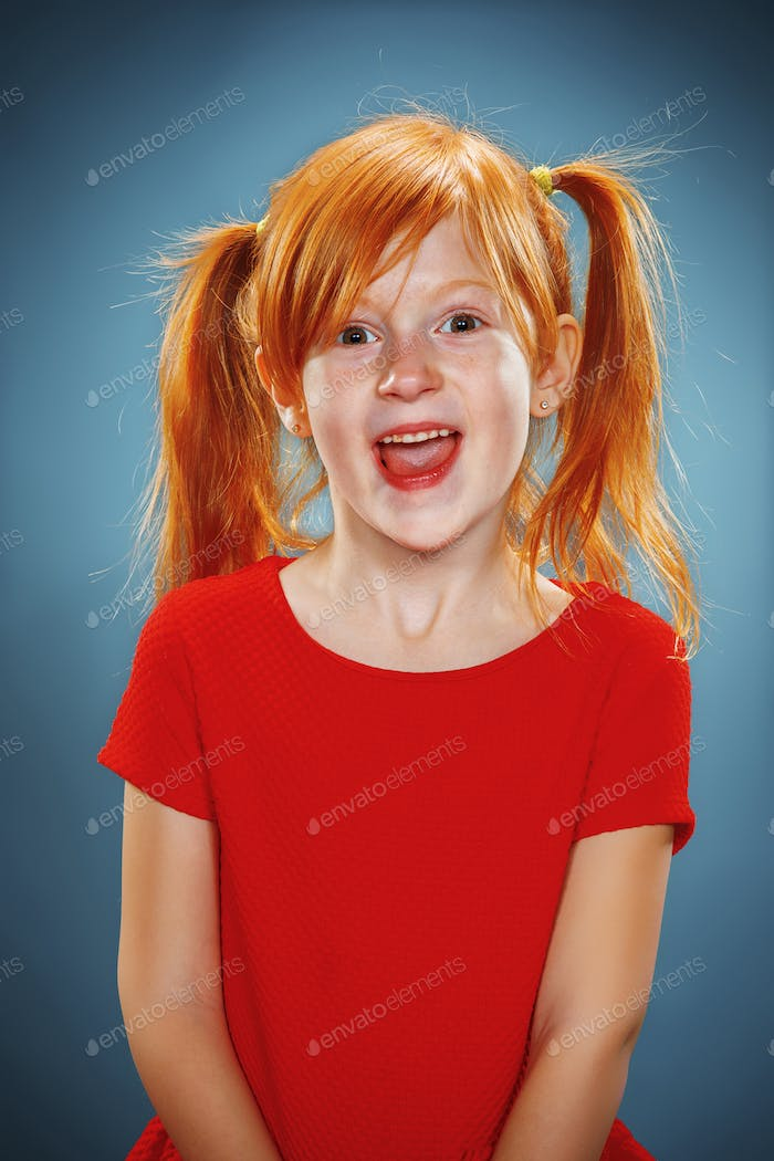 Beautiful portrait of a happy little girl smiling