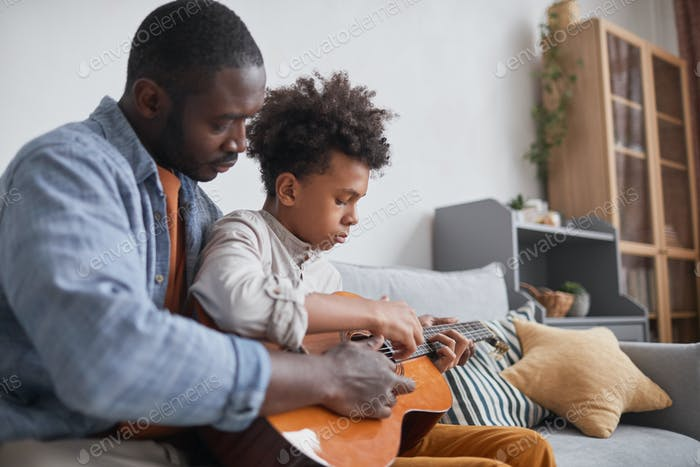 Playing Guitar with Father