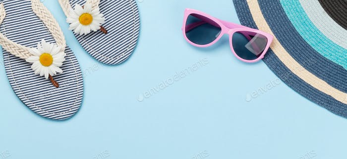 Beach flip flops with flowers and sunglasses