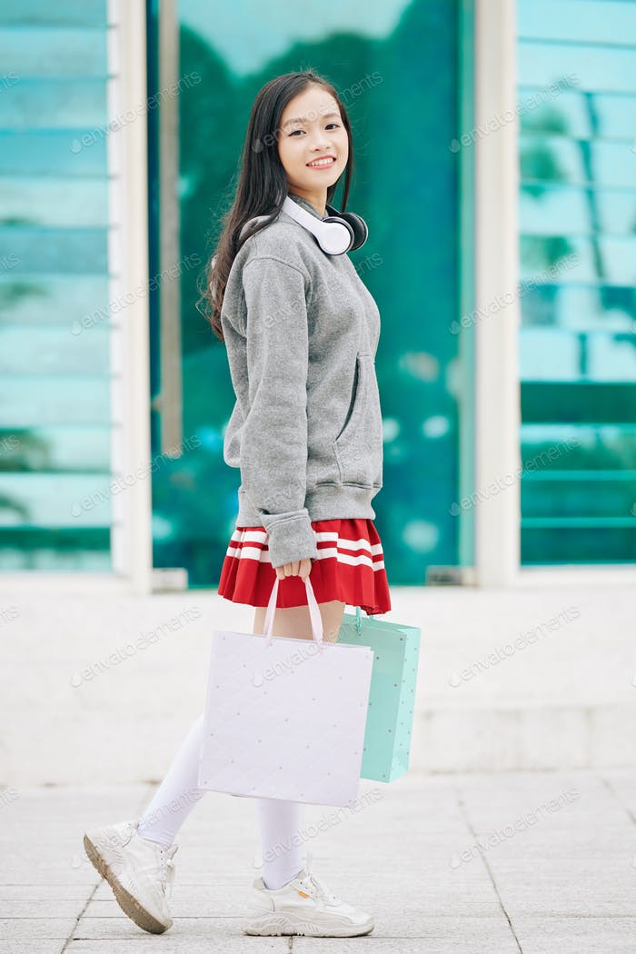Schoolgirl with shopping bags