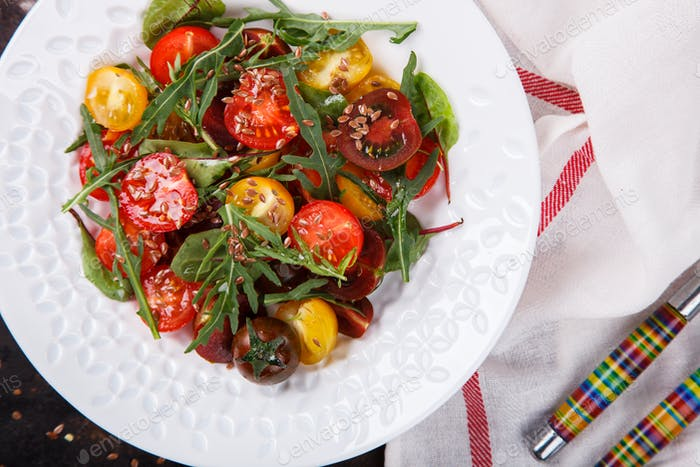 salad of fresh,colored cherry tomatoes with arugula