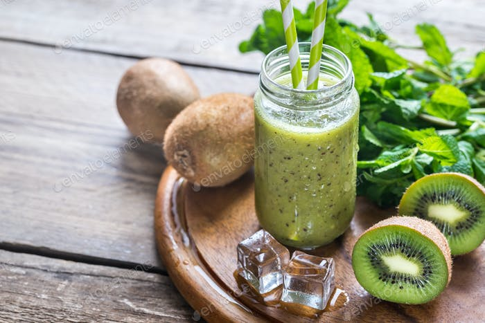 Glass jar of kiwi smoothie