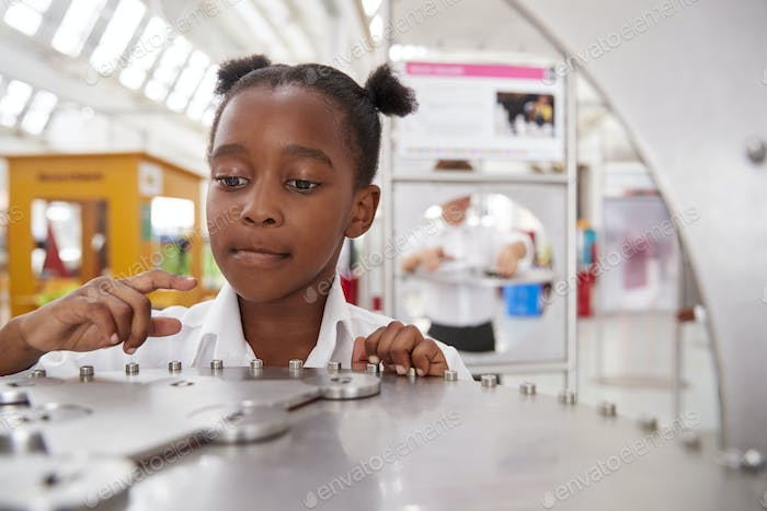 Schoolgirl taking part in a science test at a science centre