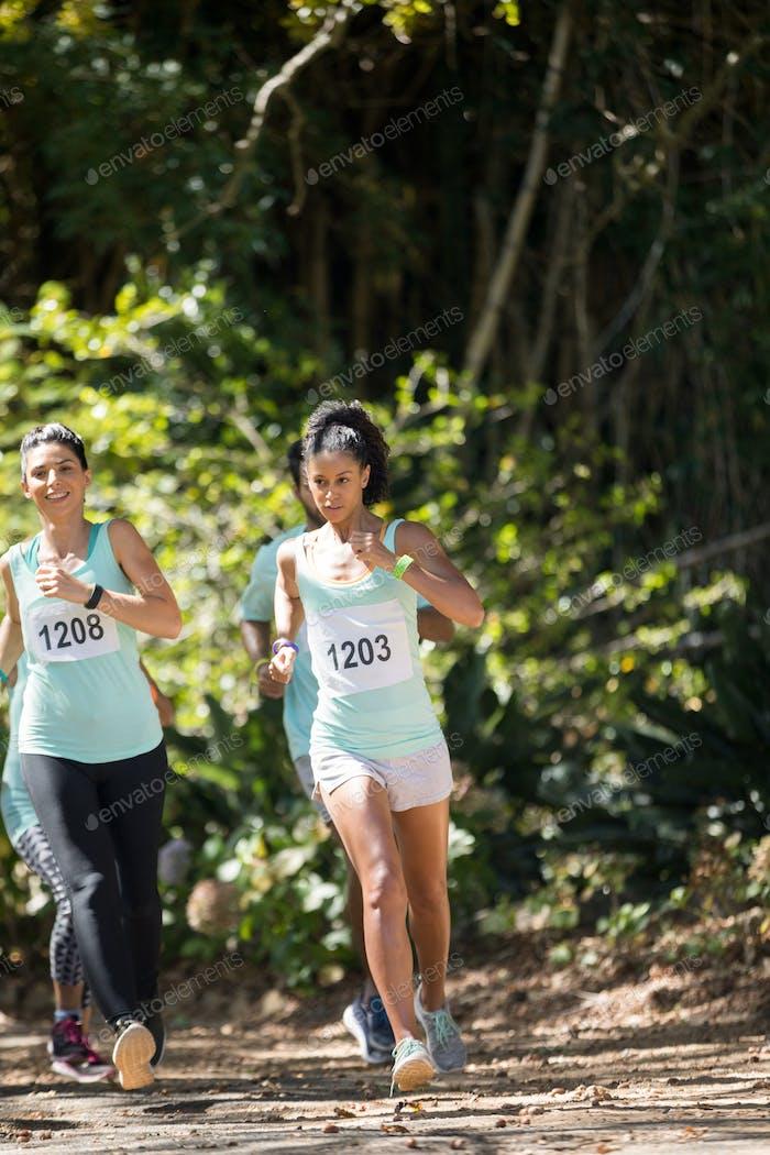 Marathon athletes running in the park