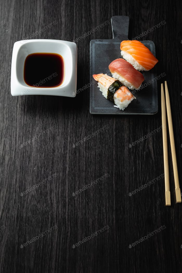 Nigiri sushi on wood table in a japanese restaurant. Copy space and top view