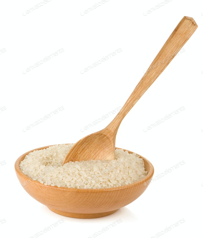 rice in wooden plate and spoon isolated on white