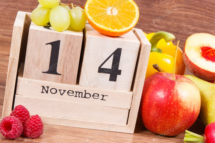 Date of 14 November on calendar and fruits with vegetables, world diabetes day concept