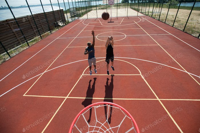 Basketball Match in Sunlight