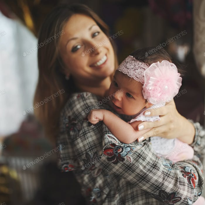 young mother with cute newborn baby