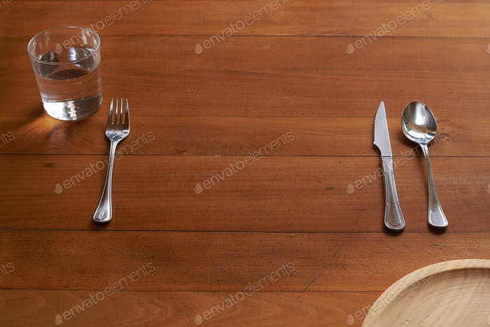 Empty space for a plate against a wood background