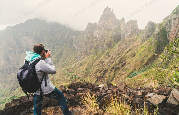 Santo Antao Island, Cape Verde. Male traveler photographing mountain peaks in surreal Xo Xo valley