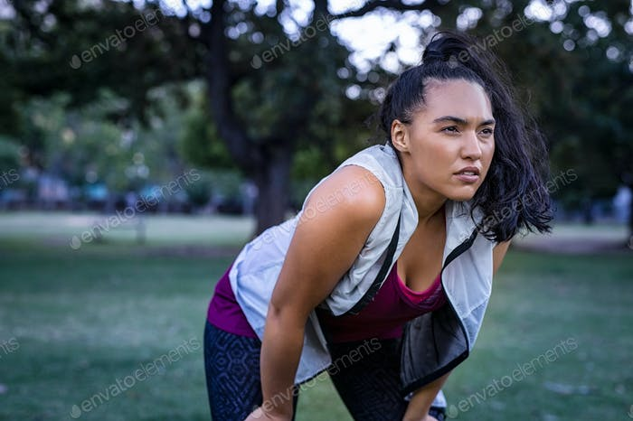 Curvy woman tired after running