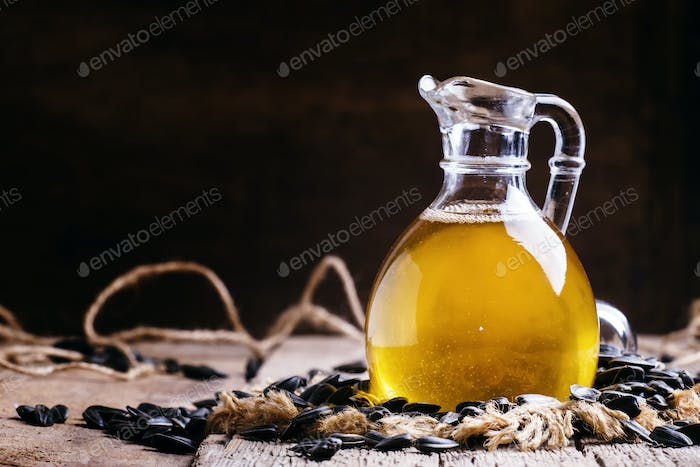 Freshly squeezed sunflower oil in a glass jug