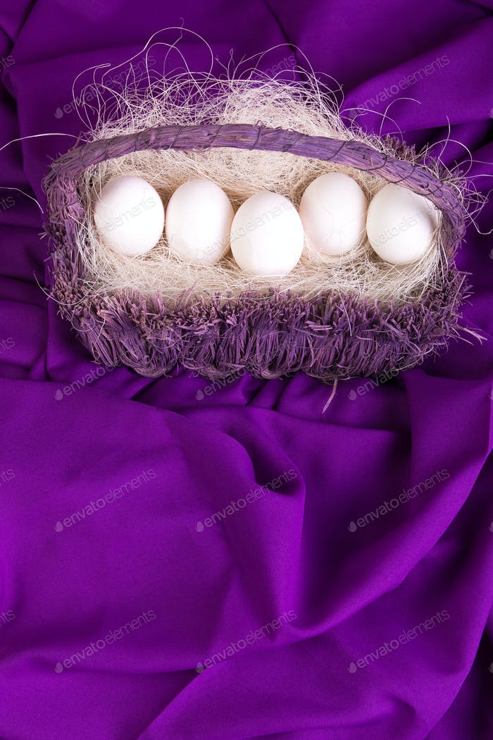 Easter. White eggs in purple basket