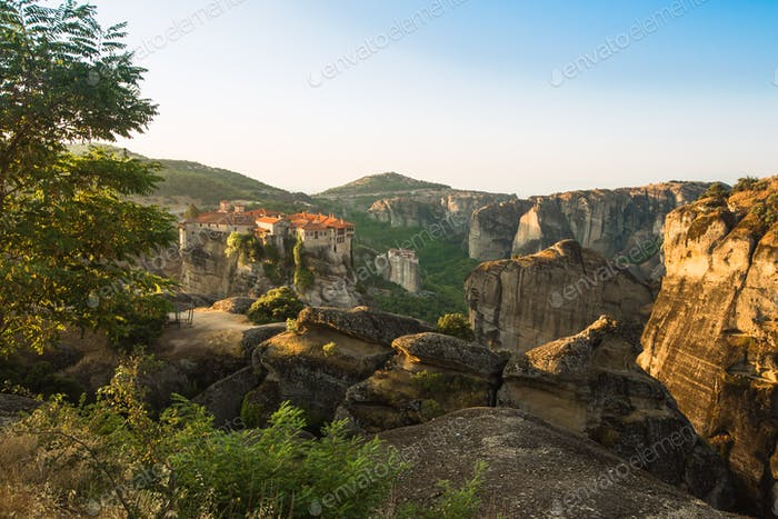 First sun rays on the Holy Monastery of Varlaam on the edge of high rock. Kalambaka, Greece