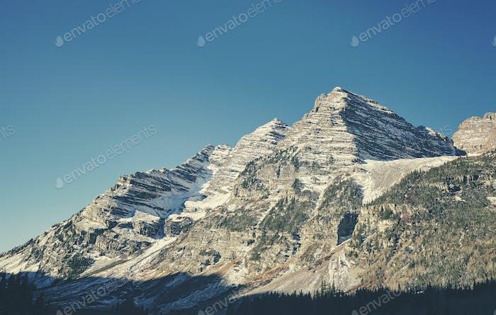 Retro toned Maroon Bells mountain range, USA.