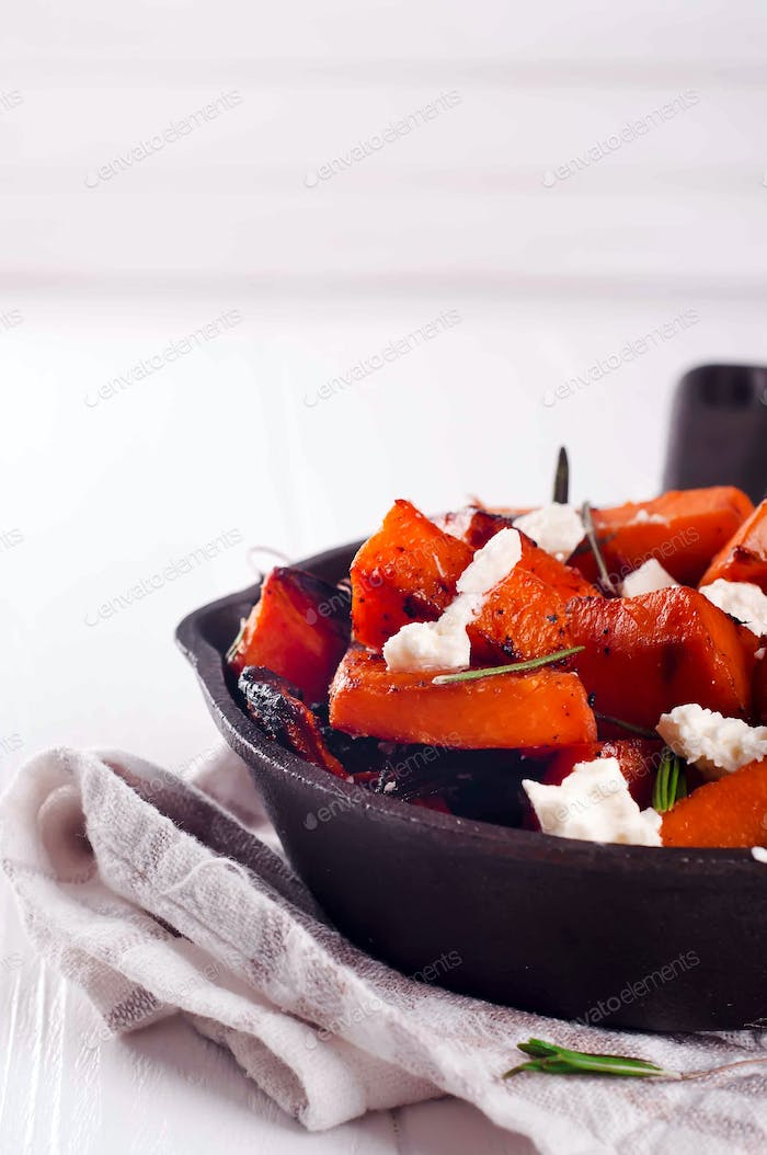 Thumbnail for Roasted, baked pumpkin with addition aromatic herbs and goat cheese