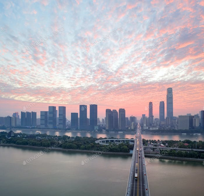 changsha in sunrise,the bridge over the beautiful xiangjiang river, China