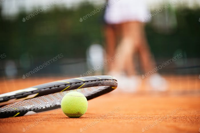 Close up of tennis balls on tennis court. Sport concept