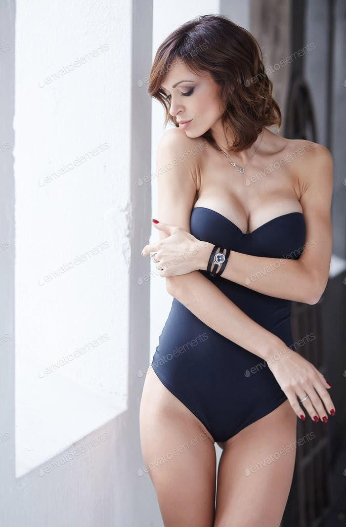 A woman in a black underwear.