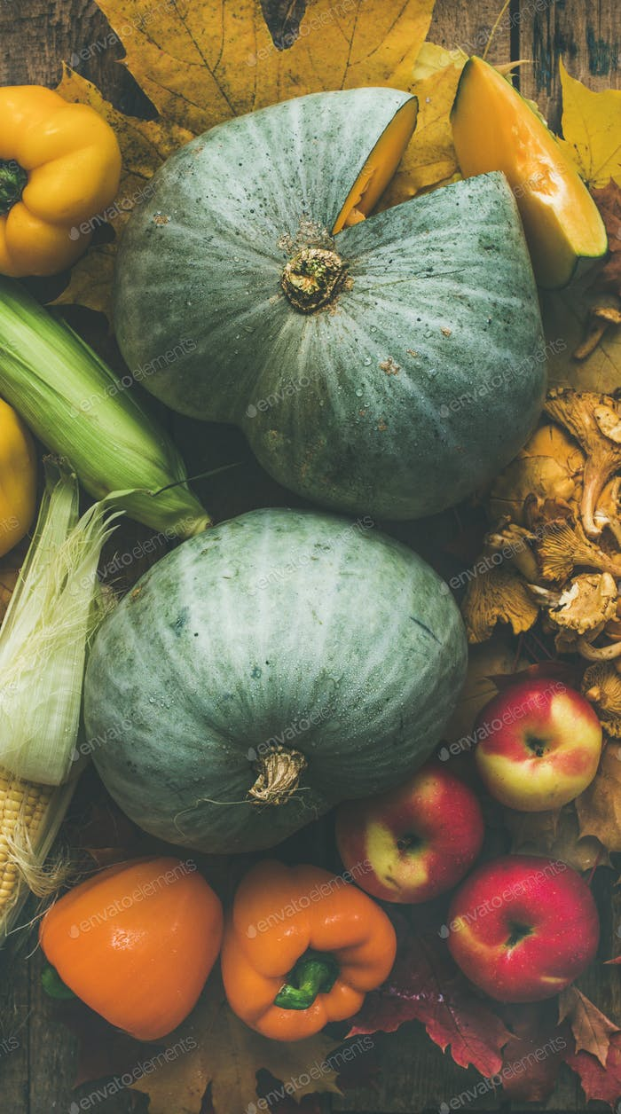 Fall colorful vegetables assortment over wooden table background. Food texture