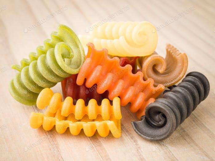 Italian pasta seven flavors on wooden base