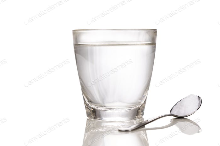 ORS or oral rehydration salt with glass of water and spoon