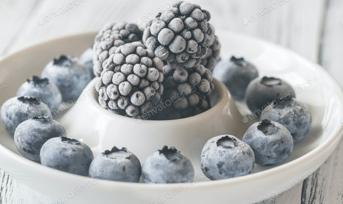 Frozen blueberries and blackberries on the plate