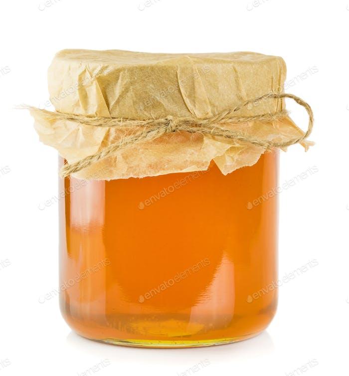 A glass jar of honey