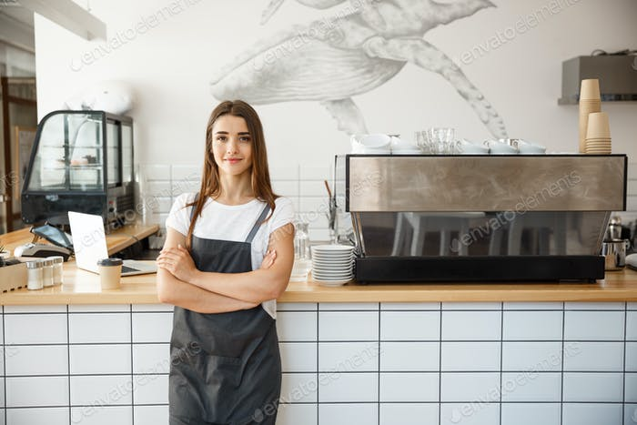 Coffee Business owner Concept - Portrait of happy attractive young beautiful caucasian barista in