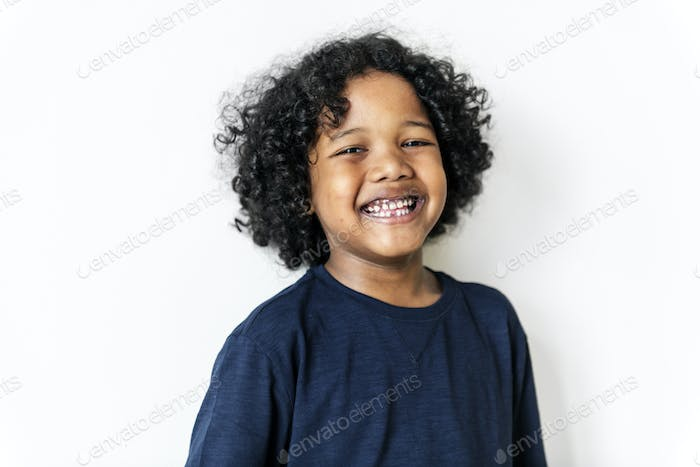 Portriat of young cheerful black boy