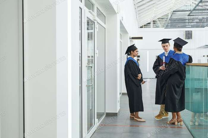 A group of people in graduation gowns indoors