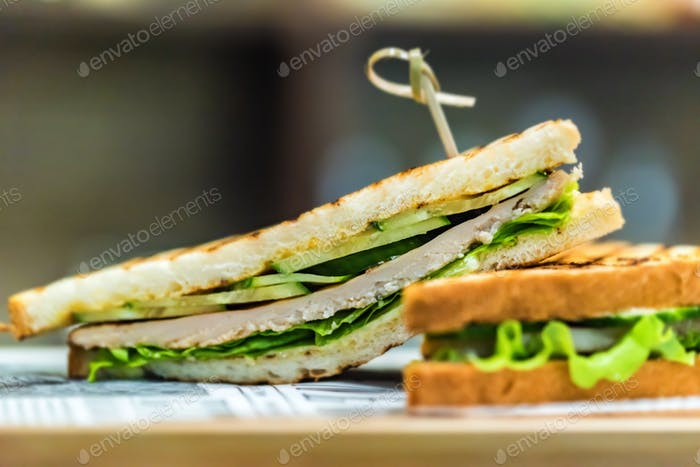 Delicious grilled sandwiches with lettuce close